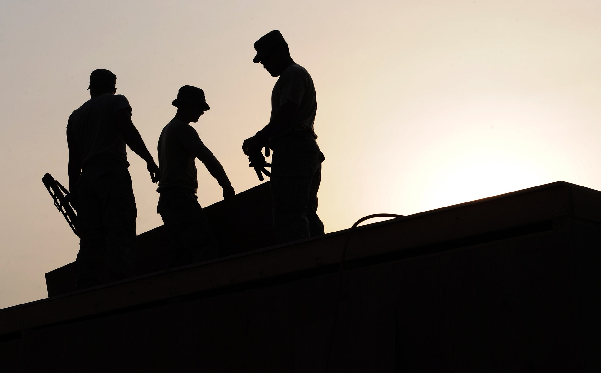 Construction workers on a site. Representing Worker's Compensation