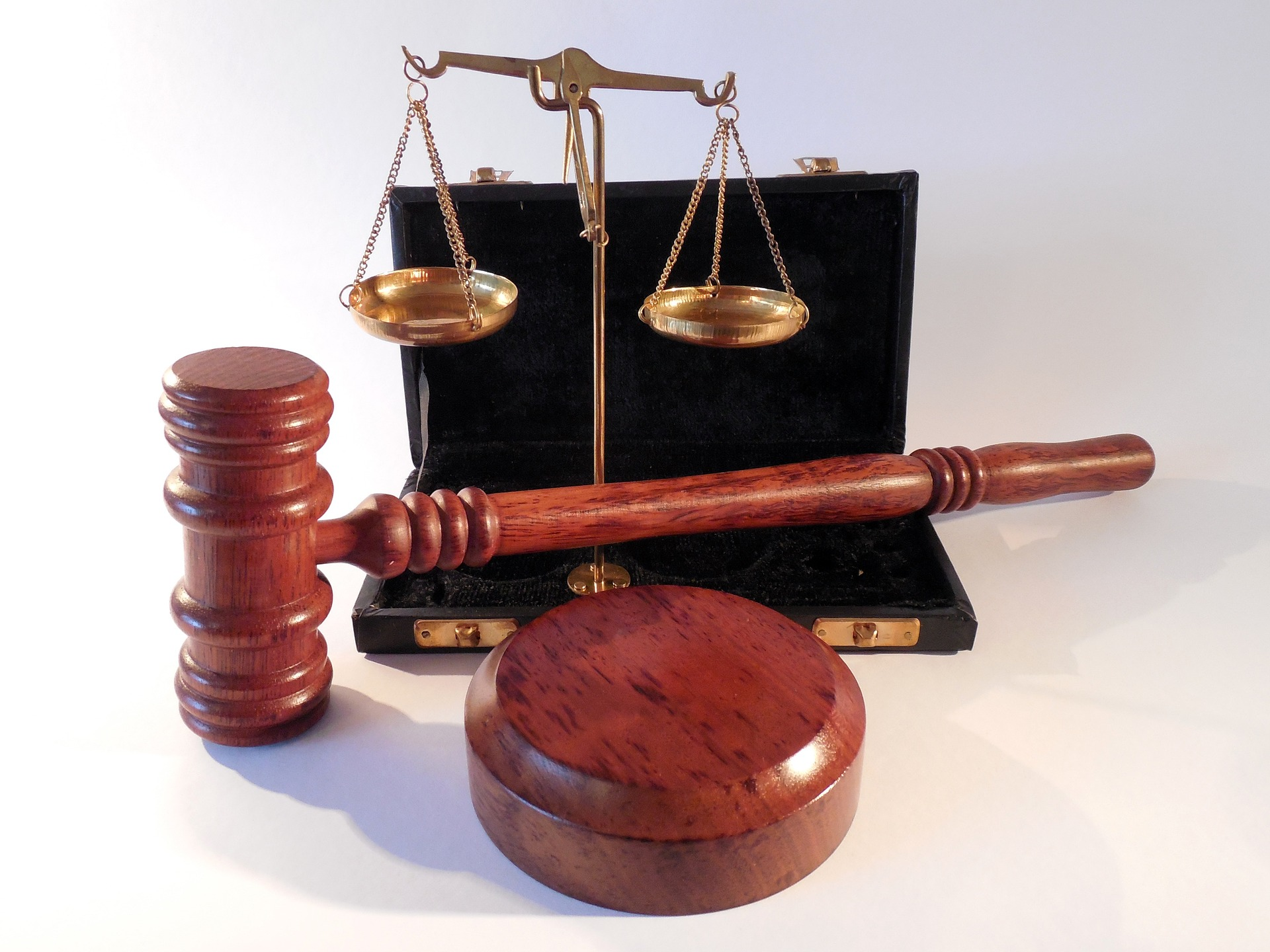 Gavel and justice scales. Represents multiple areas of law. Personal injury lawyers.